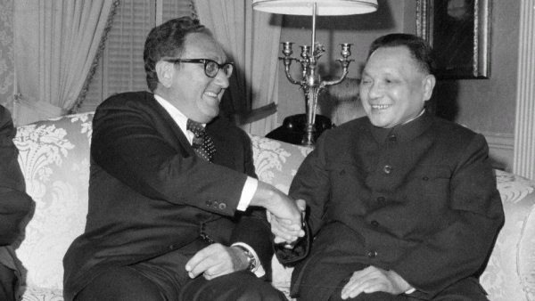 (Original Caption) New York: US Secretary of State Henry Kissinger chats with Vice Premier Deng Xiaoping of China at a dinner here 4/14. Deng is the highest-ranking official of the People's Republic of China ever sent to the US. 4/15/1974