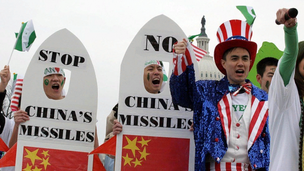 Taiwanese-Americans demonstrate 26 March, 2005, near the US Capitol (rear) in Washington, DC, to protest China's anti-secession law. The controversial anti-secession law, passed by the Chinese parliament last week, authorizes the use of military force against Taiwan if the island moves toward formal independence.