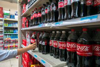 """中国营养政策背后,""""垃圾食品""""公司的身影"""