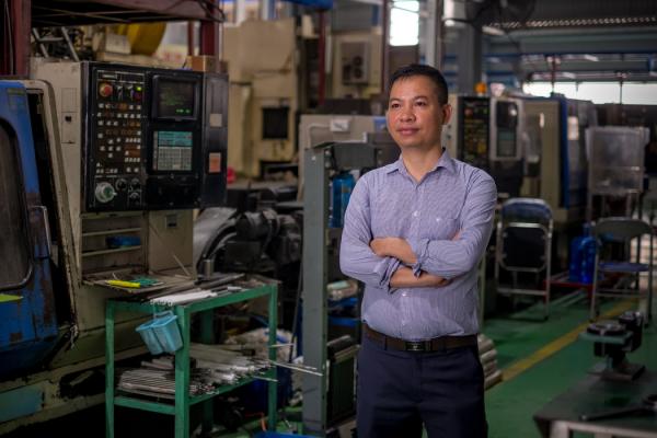Fitek公司董事会主席武进强,该公司为三星、佳能和其他大公司生产工业设备。
