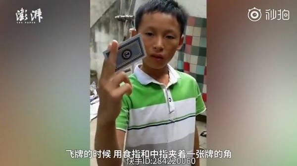 河南11岁男孩炼成飞牌神技 飞牌可扎穿木板-玩懂手机网 - 玩懂手机第一手的手机资讯网(www.wdshouji.com)