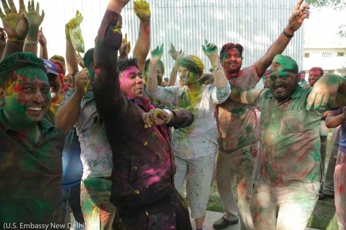People dancing for Holi, covered in multicolored dye (U.S. Embassy New Delhi)