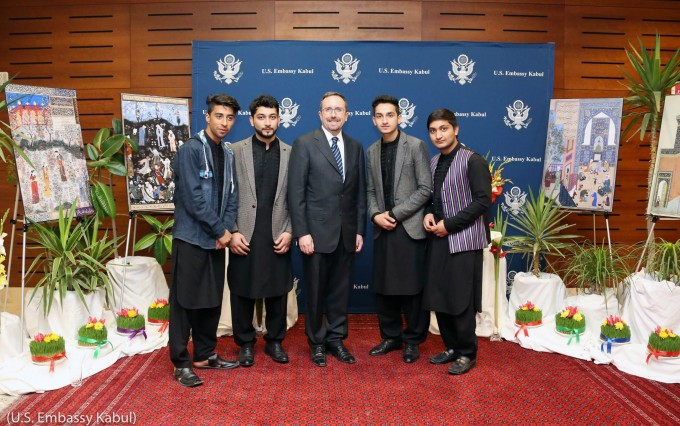 Five men lined up for a picture in front of Nowruz decorations (U.S. Embassy Kabul)
